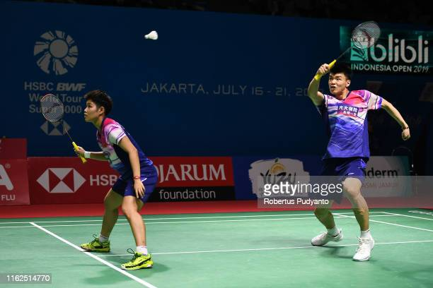 Wang Li Yu and Huang Dong Ping of China compete against Wang Chi Lin and Cheng Chi Ya of Chinese Taipei on day two of the Bli Bli Indonesia Open at...