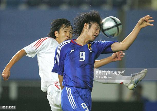 Wang Liang of China vies for a ball with Seiichiro Maki of Japan during a match in the East Asian Football Championship on August 3, 2005 in Daejeon,...