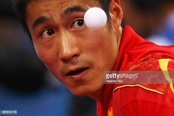 Wang Liqin of China competes on his way to finishing third in the Men's Singles Bronze Medal Match held at the Peking University Gymnasium on Day 15...