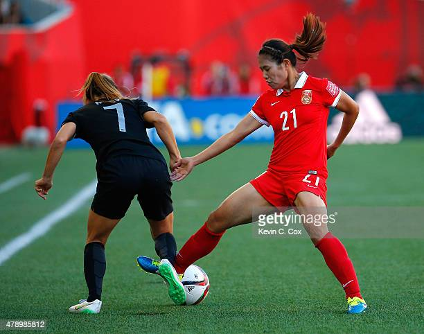 Wang Lisi of China PR against Ali Riley of New Zealand during the FIFA Women's World Cup Canada 2015 Group A match between China PR and New Zealand...