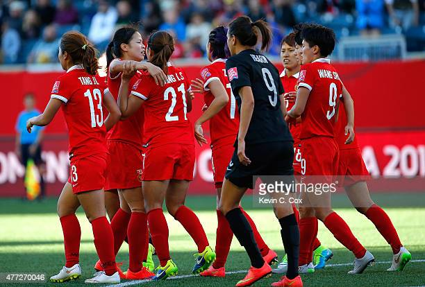 Wang Lisi of China PR celebrates their first goal against New Zealand with teammates during the FIFA Women's World Cup Canada 2015 Group A match...