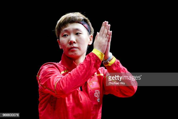 Wang Manyu of China attend the award ceremony at the women's singles final compete with Ding Ning of China during the 2018 ITTF World Tour China Open...