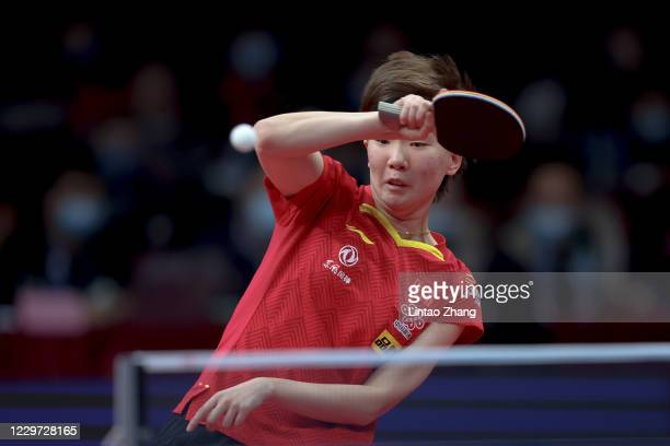 Wang Manyu of China competes against Chen Meng of China during women's single final match on day four of 2020 ITTF Finals at Zhengzhou Olympic Sports...