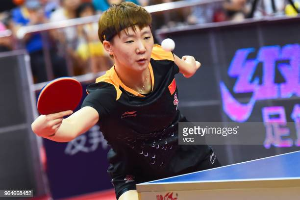 Wang Manyu of China competes in the Mixed Doubles quarterfinal match against Lee Sangsu and Jeon Jihee of South Korea during day one of the 2018 ITTF...