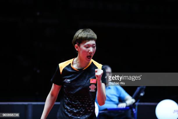 Wang Manyu of China in action at the women's singles quarterfinal compete with Han Ying of Germany during the 2018 ITTF World Tour China Open on June...
