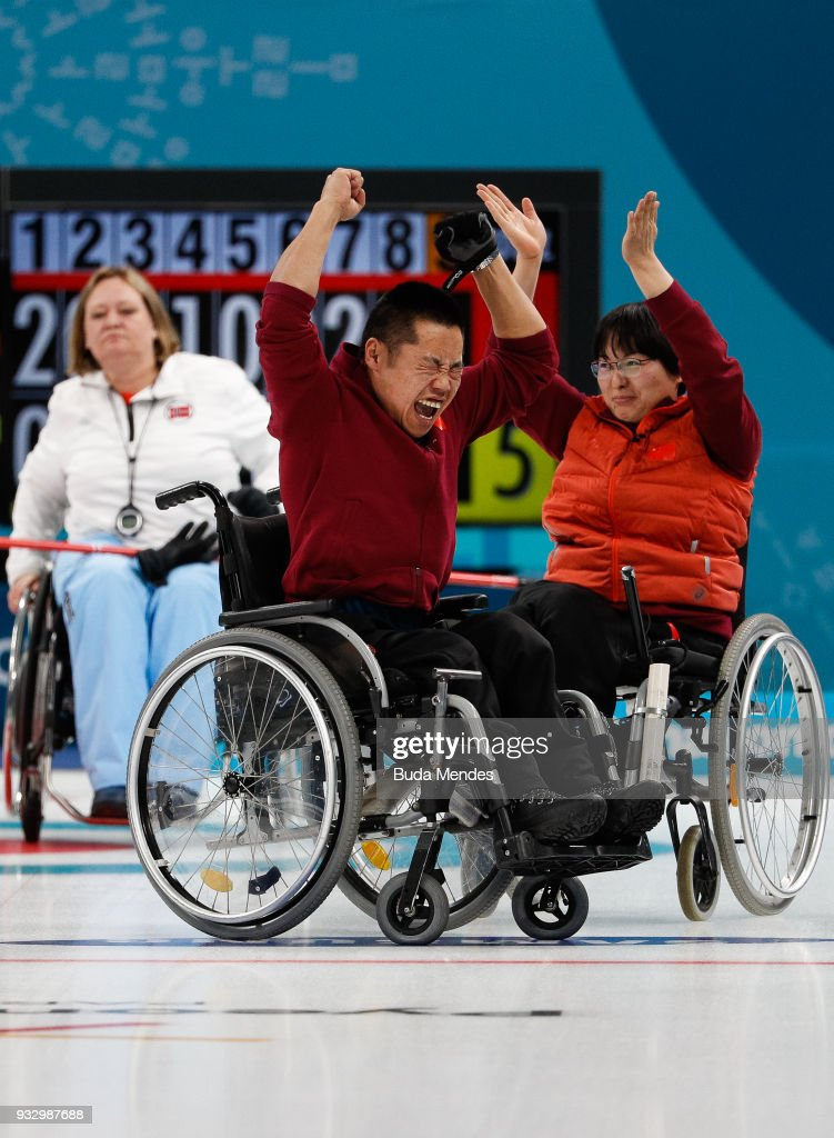 Wang Meng of China and Liu Wei of China celebrate after defeating Norway in the Curling Mixed Golden Medal match between China and Norway during day eight of the PyeongChang 2018 Paralympic Games on March 17, 2018 in Gangneung, South Korea.