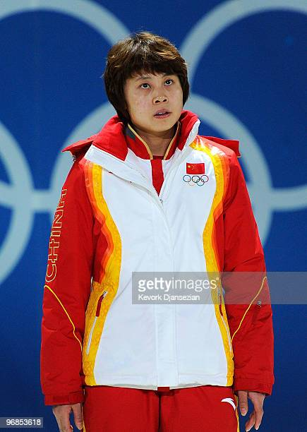 Wang Meng of China celebrates winning gold during the medal ceremony for the Ladies' 500 m Short Track on day 7 of the Vancouver 2010 Winter Olympics...