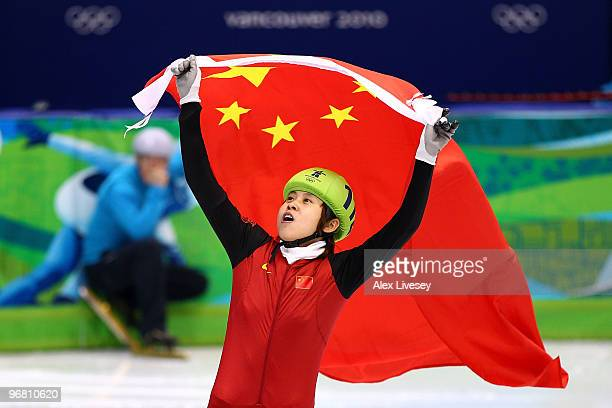 Wang Meng of China celebrates winning the gold medal in the Short Track Speed Skating Ladies' 500 m finals on day 6 of the Vancouver 2010 Winter...