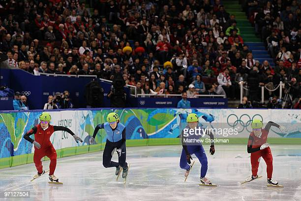 Wang Meng of China Katherine Reutter of the United States Park SeungHi of South Korea and Zhou Yang of China start the Ladies 1000m Short Track Speed...