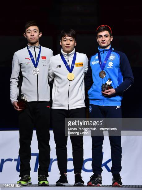Wang Pengyu of China Chang Hyun Woo of Korea and Pietro Sighel of Italy pose with their medals after finishing in the top three of the men's 1500...
