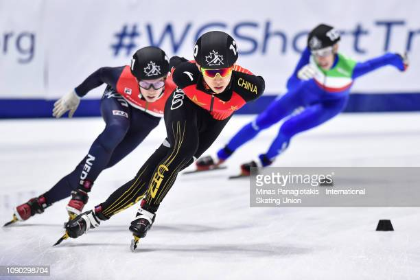 Wang Pengyu of China skates ahead of Bram Steenaart of the Netherlands and Pietro Marinelli of Italy in the men's 1000m heat during the ISU World...