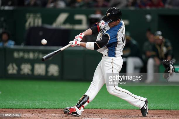 Wang Pojung of the Hokkaido NipponHam Fighters hits a RBI double to make it 13 in the bottom of 6th inning during the preseason friendly game between...