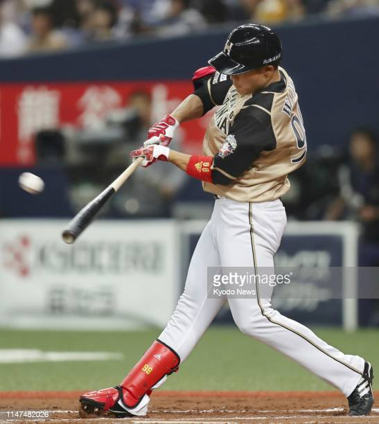 Wang Pojung of the Nippon Ham Fighters hits a double in the eighth inning against the Orix Buffaloes at Kyocera Dome in Osaka on June 2 his fifth hit...