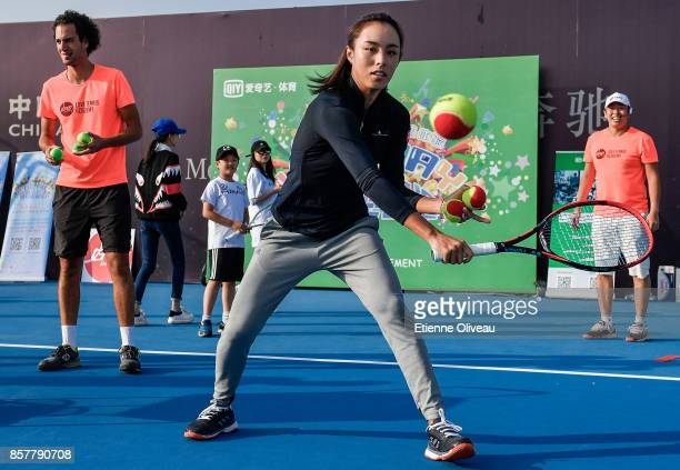 Wang Qiang of China attends the iQiYi kids day on day six of the 2017 China Open at the China National Tennis Centre on October 5, 2017 in Beijing,...