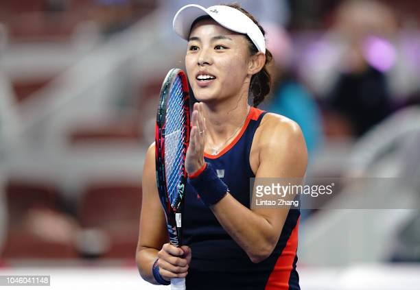 Wang Qiang of China celebrates after defeating Aryna Sabalenka of Belarus during her Women's Singles quarterfinals match in the 2018 China Open at...
