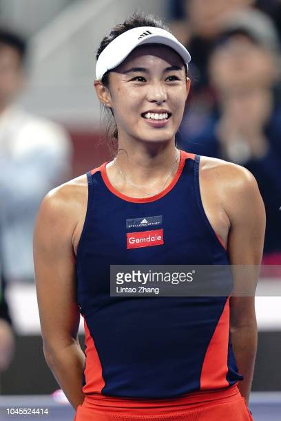 Wang Qiang of China celebrates after defeating Karolina Pliskova of the Czech Republic during their Women's Singles 3rd Round match of the 2018 China...