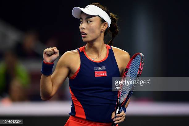 Wang Qiang of China celebrates after winning a point during her Women's Singles quarterfinals match against Aryna Sabalenka of Belarus in the 2018...