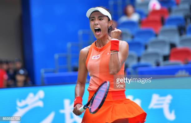 Wang Qiang of China celebrates after winning the first round match against Sloane Stephens of the United States on Day 2 of 2017 Dongfeng Motor Wuhan...