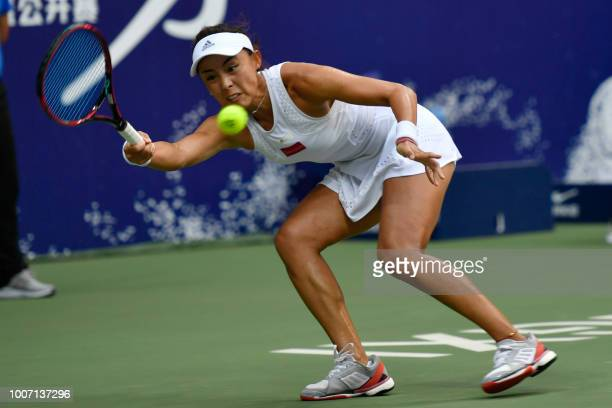 Wang Qiang of China hits a return against compatriot Zheng Saisai in their women's singles final match of the Jiangxi Open tennis tournament in...