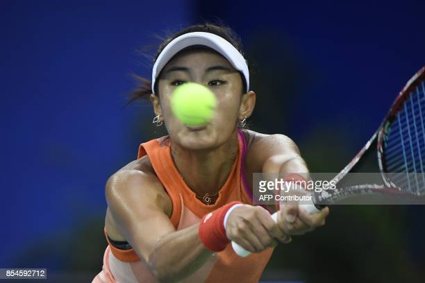 Wang Qiang of China hits a return against Karolina Pliskova of Czech Repubic during their third round women's singles match at the WTA Wuhan Open...