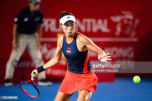 Wang Qiang of China hits a return during her quarterfinal women's singles match against Elina Svitolina of Ukraine at the Hong Kong Open tennis...