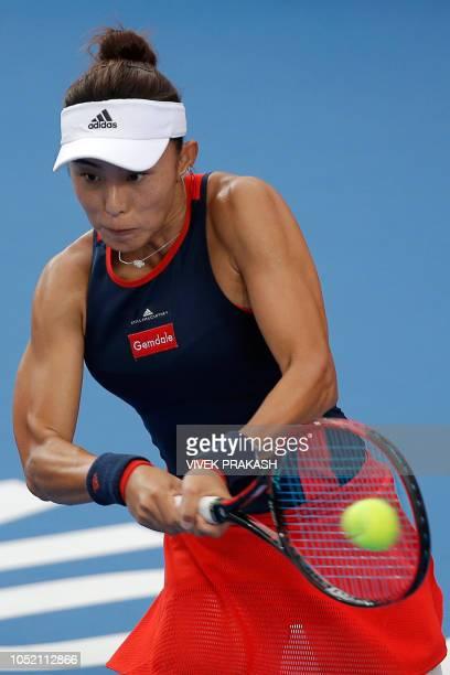Wang Qiang of China hits a return during her women's singles final match against Dayana Yastremska of Ukraine at the Hong Kong Open tennis tournament...