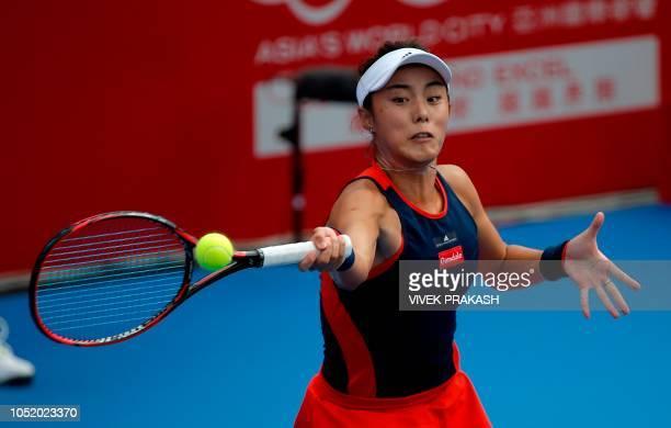 Wang Qiang of China hits a return to Elina Svitolina of Ukraine during her women's singles quarterfinal match at the Hong Kong Open tennis tournament...