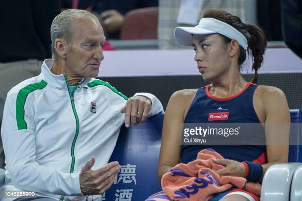 Wang Qiang of China listens to her coach Peter McNamara during her game against Karolina Pliskova of the Czech Republic at their Women's Singles 3rd...