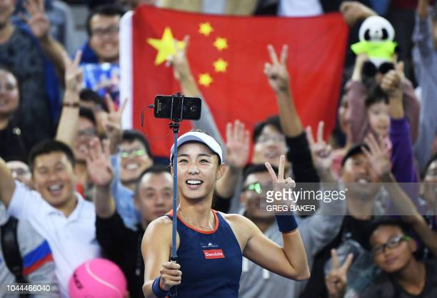 TOPSHOT Wang Qiang of China poses for a selfie after winning her women's singles second round match against Jelena Ostapenko of Latvia at the China...