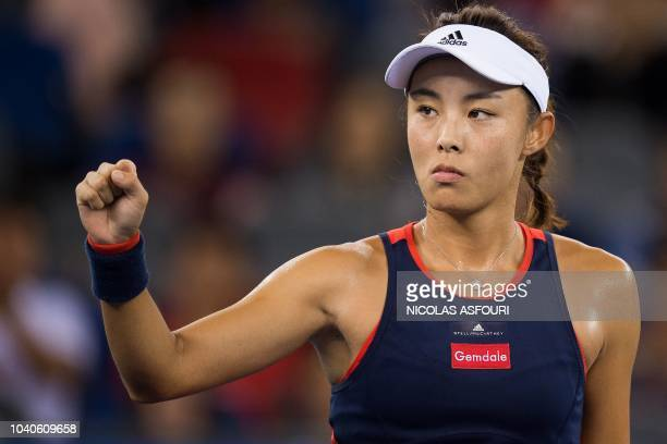 Wang Qiang of China reacts after winning a point against Daria Gavrilova of Australia during their women's singles third round match of the WTA Wuhan...