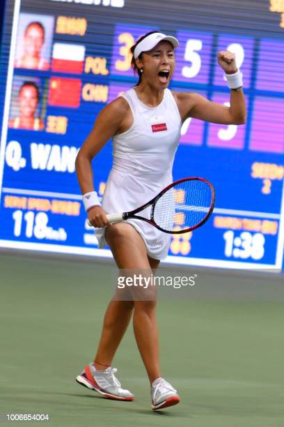 Wang Qiang of China reacts during her women's singles semifinal match against Magda Linette of Poland in the Jiangxi Open tennis tournament in...