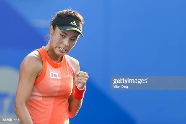 Wang Qiang of China reacts during the second round Ladies Singles match against Sorana Cirstea of Romania on Day 3 of 2017 Dongfeng Motor Wuhan Open...