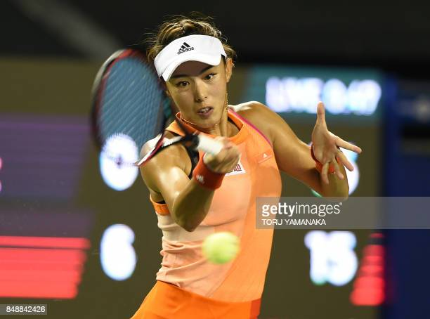 Wang Qiang of China returns a shot to Kristina Mladenovic of France during their first round match in the Pan Pacific Open tennis tournament in Tokyo...