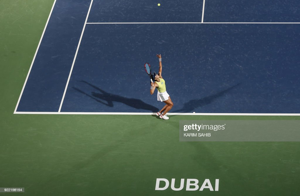 Wang Qiang of China serves the ball to Ukraine's Elina Svitolina (unseen) during their match on the second day of the WTA Dubai Duty Free Tennis Championship at the Dubai Tennis Stadium on February 21, 2018. /