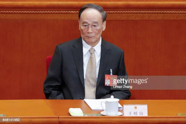 Wang Qishan a member of the Standing Committee of the Political Bureau of the Communist Party of China Central Committee and secretary of the CPC...