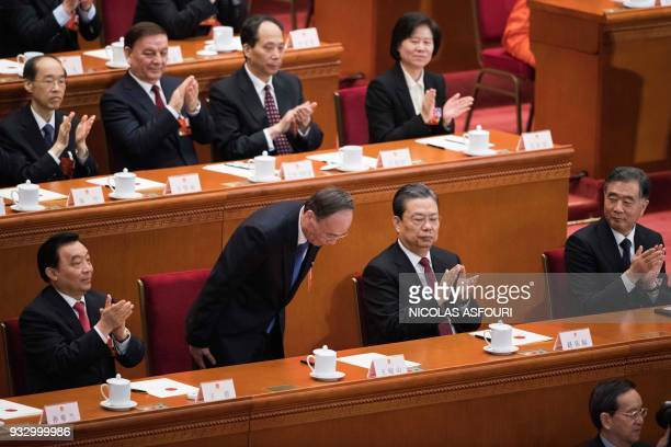 Wang Qishan former secretary of the Central Commission for Discipline Inspection bows after he was elected as China's Vice President during the fifth...