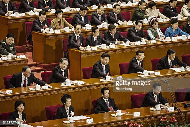 Wang Qishan secretary of the Central Commission for Discipline Inspection second row from left Yu Zhengsheng chairman of the Chinese People's...
