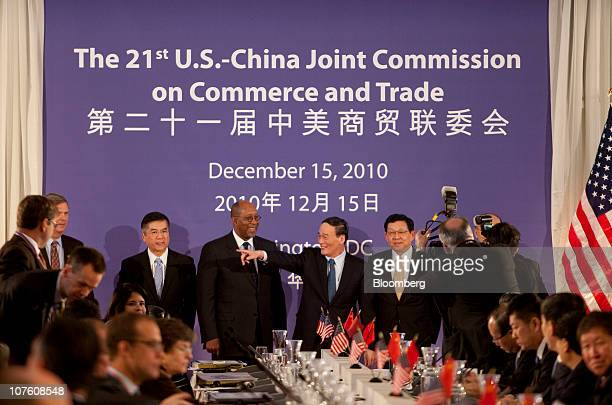 Wang Qishan vice premier of China center points as he meets with Ron Kirk US trade representative right to left Gary Locke US secretary of commerce...