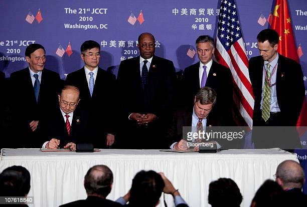 Wang Qishan vice premier of China standing left to right Gary Locke US secretary of commerce Ron Kirk US trade representative and Jon Huntsman US...