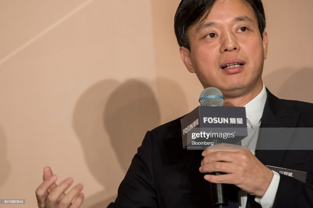 Wang Qunbin, chief executive officer of Fosun International Ltd., speaks during a news conference in Hong Kong, China, on Thursday, Aug. 31, 2017. Fosun, the listed flagship ofChinese billionaireGuo Guangchang's insurance-to-drugs conglomerate, reported first-half net income increased 34 percent amid higher returns from investments. Photographer: Paul Yeung/Bloomberg via Getty Images