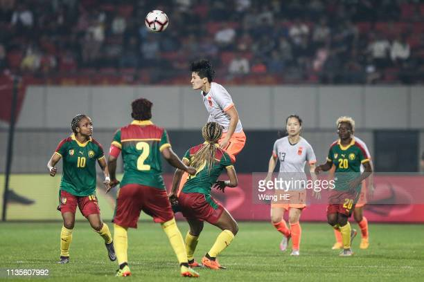 Wang Shanshan China and Cameroon palyer in action during Wuhan International Women's Football Championship between China v Cameroon at Hankou Sports...