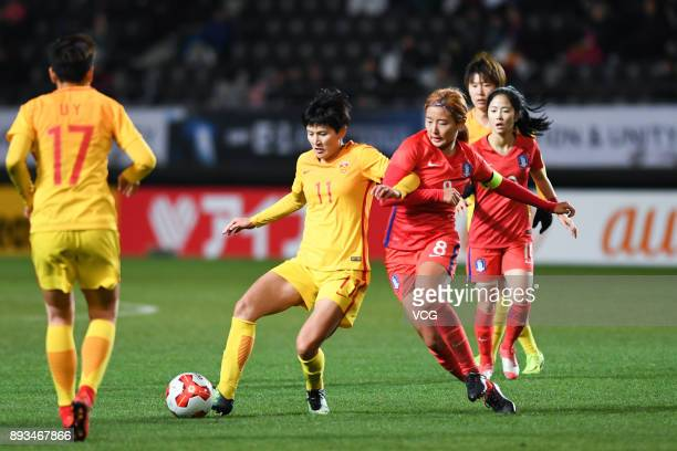 Wang Shanshan of China and Cho Sohyun of South Korea compete for the ball during the EAFF E1 Women's Football Championship between South Korea and...