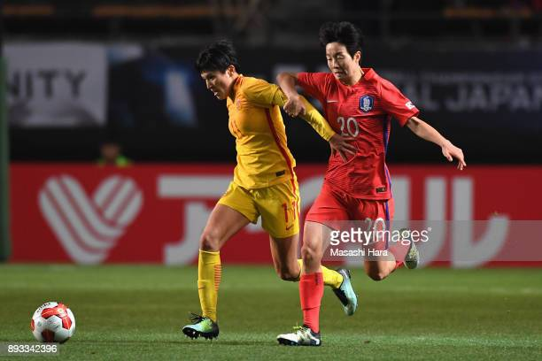 Wang Shanshan of China and Kim Hyeri of South Korea compete for the ball during the EAFF E1 Women's Football Championship between South Korea and...