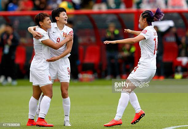 Wang Shanshan of China celebrates her goal with teammates Han Peng and Zhao Rong in their match against Cameroon during the FIFA Women's World Cup...