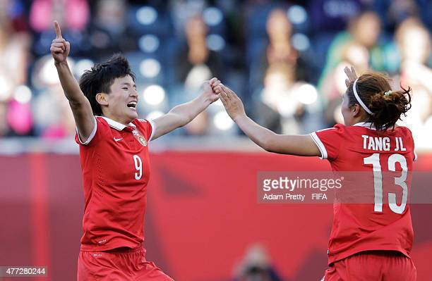 Wang Shanshan of China celebrates with Tang Jiali of China after scoring the second goal during the FIFA Women's World Cup 2015 Group A match between...