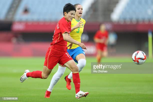 Wang Shanshan of China follows the ball in the Women's First Round Group F match between China and Brazil during the Tokyo 2020 Olympic Games at...