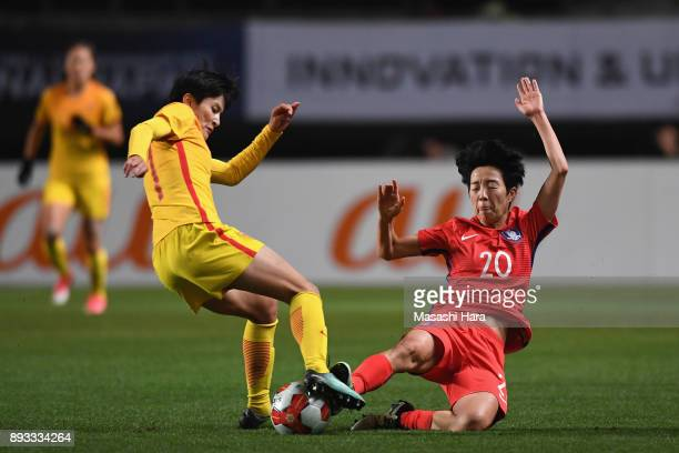 Wang Shanshan of China is tackled by Kim Hyeri of South Korea during the EAFF E1 Women's Football Championship between South Korea and China at...