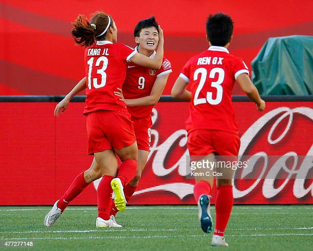 Wang Shanshan of China PR celebrates scoring their second goal against New Zealand with Tang Jiali and Ren Guixin during the FIFA Women's World Cup...