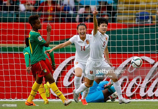 Wang Shanshan of China PR reacts after scoring the opening goal against goalkeeper Annette Ngo Ndom of Cameroon during the FIFA Women's World Canada...