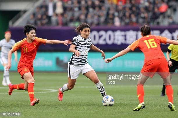 Wang Shanshan, Wang Xiaoxue of China and Cho So-hyun of South Korea fight for the ball during the Tokyo Olympics Women's Football Asian Final...